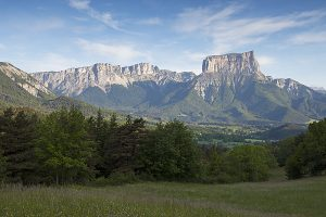Mont Aiguille low cloud and alpine meadow near Chichilianne Isere Region Vercors Regional Natural Park France June 2016