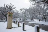 Snow scene and New Forest National Park sign at Moyles Court near Ringwood Hampshire England