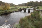Ancient clapper bridge over the East Dart river at Postbridge Dartmoor National Park Devon