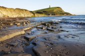 Kimmeridge Bay with the Clavell Tower beyond Jurrasic Coast Dorset