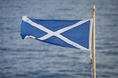 Saltire the Scottish flag flying from the stern of the Caledonian MacBrayne ferry Finlaggan Scotland UK