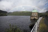 Rainbow beyond the valve tower on the Garreg Ddu reservoir Elan Valley Powys Wales September 2012