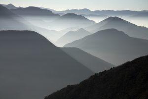 Mountains in mist at sunrise near the Col de Rousset Parc Naturel Regional du Vercors France