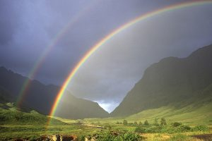 Double rainbow and Glen Coe with surrounding mountains Highland Region Scotland