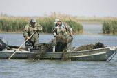 Fishermen on the River Po Valle de Gorino Delta Italy