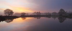 C01D2949 Sunrise over small pond