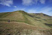 Walker looking towards Pen-y-fan Brecon Beacons National Park Wales UK 2012
