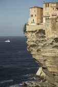 Buildings on the steep cliffs overlooking the sea Bonifacio Corsica France