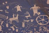Petroglyph panel of symbols carved in the desert varnish at Newspaper Rock State Historic Park Utah USA