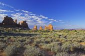 Rocky outcrops and desert vegetation in Arches National Park Utah USA