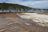 Tourists on boardwalk Midway Geyser Basin Yellowstone National Park Wyoming USA June 2015