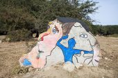 Rock paintings beside the road to Funtana Bona near Orgosolo Sardinia Italy September 2014