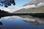 Waitake Mountains reflected in Mirror Lakes South Island New Zealand